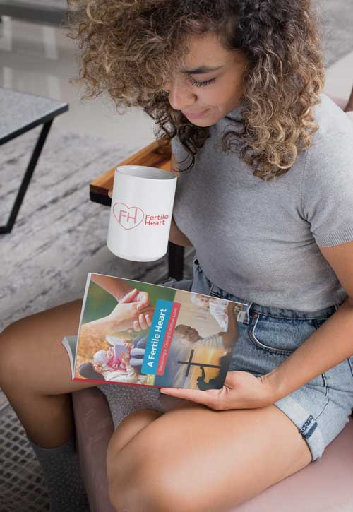 Woman reading A Fertile Heart book with a mug of coffee.